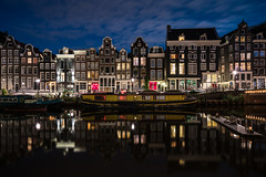 Sin City (McQuaide Photography) Tags: amsterdam noordholland northholland netherlands nederland holland dutch europe sony a7rii ilce7rm2 alpha mirrorless 1635mm sonyzeiss zeiss variotessar fullframe mcquaidephotography adobe photoshop lightroom tripod manfrotto light licht night nacht nightphotography longexposure stad city capitalcity urban lowlight architecture outdoor outside old oud gracht grachtenpand canalhouse house huis huizen traditional authentic water reflection centrum gebouw building waterfront waterside canal colour colours color boat boot wideangle groothoek wideanglelens singel redlight redlightdistrict singelgebied windows
