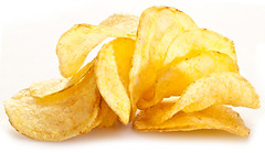 Potato chips on a white background. (jbrookston) Tags: background chip closeup crisp crispy crunchy delicious fast fatty food fried golden heap ingredient isolated junk lunch macro nosh pepper pile potato prepared rippled salted slice snack spicy tasty unhealthy vegetable white yellow