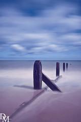 Mundesley 1 (davemoly17) Tags: davidmolyneuxphotography sea seaside beach beachhuts coast sand groynes waves water mundesley norfolk lifeboat sunny canon eos 1100d sigma wideangle