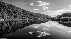 Reflective. (AlbOst) Tags: lochbeinnamheadhoin lochs scottishhighlands reflections calm reflective hazy bw blackwhite clouds monochrome laquintaessenza mirror