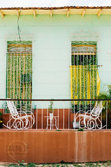 Trinidad (Simone Della Fornace) Tags: cuba trinidad travel chairs two rocking cuban old traveldestination outdoor tourism urban architecture building summer plants window relax relaxation sony a7rii