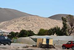 serpentine geoglyphs behind fog tents (cam17) Tags: arica chile aricachile fogcatcher garuacatcher irrigationsystem fogcatchingnet petroglyphs stonefigures atacamadesert atacama geoglyph serpentfigure figuresofmen fogtent