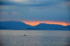 ... (danars) Tags: corf grecia perivoli acqua alba cielo azzurro nuvole mare peschereccio barca corf