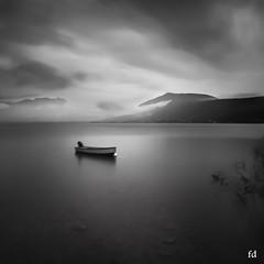Seule sous la pluie -BW (flo73400) Tags: barque lacdannecy lake lac le poselongue longexposure paysage landscape bw france