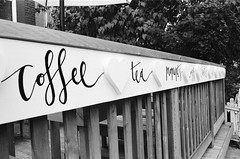 Coffee Tea (Georgie_grrl) Tags: blackandwhite toronto ontario coffee hearts cafe tea pentaxk1000 railing coffeehouse rikenon12828mm noreallyactualblackandwhitefilm wthright yesyourestillonggsphotostreambelieveitornot