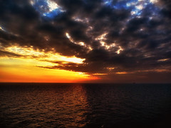 Impressive  sunset. (Bessula) Tags: autumn light sunset sea sky sun fall nature clouds boats evening spain tenerife coth bessula