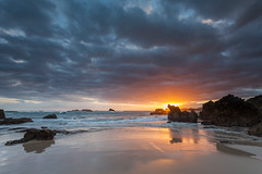 Ember (S l a w e k) Tags: ocean sea tourism beach clouds sunrise dawn coast spain sand europe glow rocky wideangle asturias playa atlantic boulders heavy llanes rugged niembro toranda cantabrian