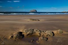Between a rock... (GenerationX) Tags: sea lighthouse beach scotland boat sand rocks waves wind unitedkingdom scottish neil seacliff dust beacon northberwick barr bassrock shipbuilding eastlothian tantallon