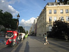 Paris 130 (AmyEAnderson) Tags: street taxis bicycles shadows building paris france europe sunset windows couple red