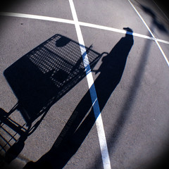 Still Life with Shopping Cart and Light Pole (MacroMarcie) Tags: shadow blackandwhite selfportrait me lines shopping myself square parking lot cart wah wh iphone selfie werehere hereios macromarcie