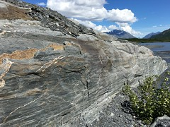 Glaciated Rock Face Worthington Glacier Valdez Alaska USA (eriagn) Tags: worthingtonglacier worthingtonglacierstaterecreationsite valdez alaska usa glacier glaciated rockface strata erosion polished grinding ice iceage lake moraine snow mountainous cloud eriagn ngairehart photography summer receding scenic landscape water stream silt gravel waterfall cascade