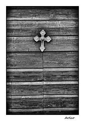Protection (Artico7) Tags: door wood blackandwhite bw italy monochrome metal blackwhite wooden fuji cross faith entrance christian protection cristiano fede croce friuli pordenone polcenigo xe1 biancoeenero