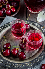 Cherry homemade liquor in a vintage glasses  on metal tray and cherries. (azimavu) Tags: cherry liquor glass red fresh drink alcohol food sweet beverage cocktail fruit liquid juice homemade berry alcoholic summer healthy refreshment table ripe background wooden cold freshness organic closeup vodka juicy nature liqueur brandy vintage shot bottle flower petal tray metal old group nobody light napkin rustic dark
