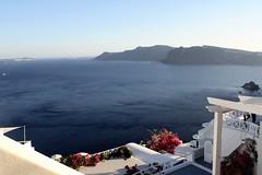 Balconies above the Aegean (msiapan) Tags: santorini greece cliffs balconies sea aegean blue flowers