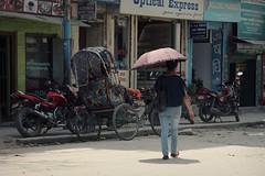 Umbrella Lady ( Jamie Mitchell) Tags: nepal kathmandu asia asian portrait street nepali nepalese umbrella rickshaw motorcycle road shops city urban