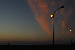 the competing lighting (claude05) Tags: sicily bonagia port lantern sunset afterglow