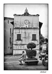 Waiting for lunchtime (Artico7) Tags: life old windows blackandwhite bw italy building clock monochrome facade bench blackwhite waiting sitting fuji bell relaxing bored piazza retired biancoenero ordinary friuli pordenone polcenigo xe1