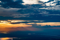 Sunset at 10,000 feet (Woodlands Photog) Tags: flying aerial sunset clouds mississippi river louisiana united airlines new orleans nola