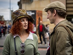 You Can Leave Your Hat On (Leanne Boulton) Tags: depthoffield urban street candid portrait portraiture groupshot streetphotography candidstreetphotography candidportrait streetlife man woman male female face faces facial expression interaction hat hats ginger redhead hair tone texture detail bokeh natural outdoor light shade shadow city scene human life people living humanity society culture fashion style canon 7d 50mm color colour edinburgh scotland uk