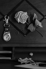 """Desktop Still Life"" (Week 4/52) (milmonfharrison) Tags: driedflower monochrome blackandwhite stilllife desktop writingdesk flower rose watch pen fountainpen paper letter key leaf dryflower 50mmf18 detail lightandshadow"