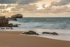 Rocks & Sea III (Agustn Achtegui) Tags: rocas rocks arena sand playa beach nubes clouds sunset puesta sol
