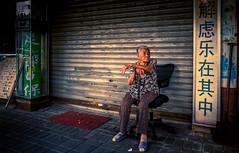 Lady in the Light (Rob-Shanghai) Tags: people street shanghai china streetphotography old sitting waiting senior shopfront leicaq