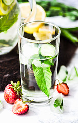 Water with strawberries, lemon, ice, mint. Detox. (harmonyandtaste) Tags: background beverage citrus cocktail cold cucumber detox detoxwater diet drink fresh freshness fruit glass green health healthy ice infused jug juice lemon lemonade lifestyle lime liquid mineral mint natural nature nutrition refreshment selectivefocus spring strawberry summer table tone vegetable vitamin water wooden yellow