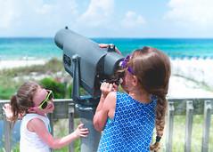 Girls of Summer (NEXtographer) Tags: emount wildlife beach lookingglass kids outside fe35mmf14za gulfworld water telescope outdoors sony zoo florida outdoor