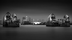 Thames Barrier (vulture labs) Tags: city uk longexposure blackandwhite bw building london skyline skyscraper mono nikon industrial cityscape skyscrapers unitedkingdom o2 monotone monochromatic docklands canarywharf d800 thamesbarrier isleofdogs daytimelongexposure neutraldensityfilter 1424mm vulturelabs prostop d800e irnd