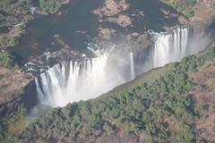 Flying over Victoria Falls (www.JnyAroundTheWorld.com - Pictures & Travels) Tags: zimbabwe zambia vicfalls victoriafalls helicopter flight africa landscape 7wonders nature waterfalls falls cascade cascades canon jnyaroundtheworld jenniferlavoura