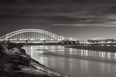 Runcorn-Silver Jubilee bridge (Elysian-Photography) Tags: uk longexposure bridge trees england seascape reflection water monochrome leaves architecture night lights blackwhite sand arch cheshire northwest towers steam gas nighttime naturereserve infrastructure coal waterscape runcorn widnes coolingtowers biomass lighttrail halton longshutterspeed manchestershipcanal rivermersey runcornbridge silverjubileebridge northwestengland fiddlersferrypowerstation wiggisland motthayandanderson runcorngap cuerdley