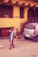 yay!! i got my snack (ThatCanonDude) Tags: life street morning dog india colors girl car photography raw no parking bangalore scene