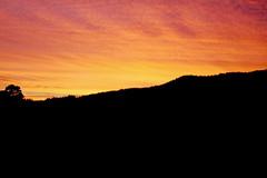 Evening sky (Gijs de Blauw) Tags: red sky orange sun moon mountain color night contrast evening dusk colored sillohuette