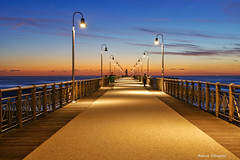 Ghost (Darea62) Tags: ghost sunset bridge david bluehour streetlights seascape marinadipietrasanta versilia tramonto architecture tuscany toscana pietrasanta pier jetty railing