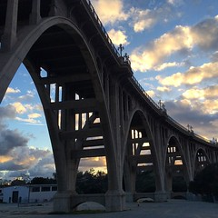 Another photo of the Colorado Street Bridge at sunset in Pasadena. Never enough! (Karol Franks) Tags: bridge storm architecture clouds square losangeles route66 historic socal squareformat pasadena iphoneography instagramapp uploaded:by=instagram foursquare:venue=4ba2e47ef964a520ea2038e3 titlecoloradostreetbridge nationalregister81000156