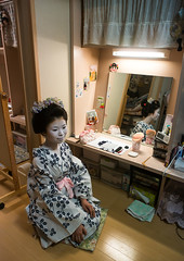 16 Years old maiko called chikasaya in her geisha house, Kansai region, Kyoto, Japan (Eric Lafforgue) Tags: woman white reflection beautiful beauty face japan vertical female hair asian japanese mirror clothing eyes kyoto colorful asia pretty feminine painted young culture makeup grace indoors teen maiko geisha teenager kimono gion tradition fullframe oriental youngadult solitary hairstyle youngwoman apprentice oneperson hairbun elaborate kanzashi 1617years oneyoungwomanonly waistup 1people kansairegion japaneseethnicity colourpicture japan161690 chikasaya komayaokiya