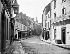 Abbey Street, Ennis, County Clare (National Library of Ireland on The Commons) Tags: robertfrench williamlawrence lawrencecollection lawrencephotographicstudio thelawrencephotographcollection glassnegative nationallibraryofireland ennis countyclare abbeystreet carmodyshotel queenshotel consodine butchers dogs singers