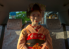 16 Years old maiko called chikasaya in a taxi, Kansai region, Kyoto, Japan (Eric Lafforgue) Tags: 1617years 1people apprentice asia asian beautiful beauty chikasaya closeup clothing colorful colourpicture culture elaborate eyes face female feminine front geisha gion grace hair hairstyle horizontal japan japan161730 japanese japaneseethnicity kanzashi kimono komayaokiya kyoto lookingatcamera maiko makeup oneperson oneyoungwomanonly oriental painted pretty solitary sun taxi teen teenager tradition white woman young youngadult youngwoman kansairegion giappone   japo japonia japonsko japonya jepang jepun  oo