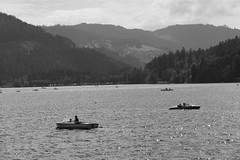 boating tourists (4) (BZK2011) Tags: titisee leica vlux schwarzweis blackandwhite lake boats touristen tourists
