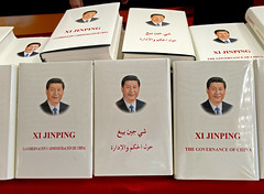 Xi's Little White Book (cowyeow) Tags: books government mindcontrol evil translation faith belief religion formal hotellobby china chinese badenglish funny funnysign funnychina badsign asia asian guangdong wrong strange bad sign guangzhou weird propaganda tradeshow book selling xijinping chairman leader politics control