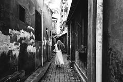 Long hair fluttering (Huang Qing) Tags: china street blackandwhite bw film girl monochrome kodak candid 28mm streetphotography snap 400tx negative gr1s ricoh trix400