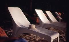 Relax (Jack Denny) Tags: sea film hat relax 50mm nikon f14 seychelles sunbathing fm2 cappello velvia100f