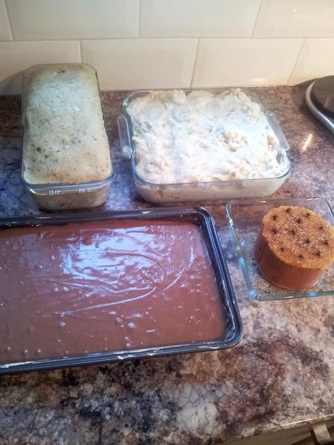 CHRISTMAS EVE food prep: (clockwise top L to R) cauliflower cheeze, baked ham, chocolate sponge and nut roast.