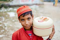 Little Red Moulavi (Sheikh Shahriar Ahmed) Tags: boy portrait food smile digital happy kid nikon madrasah muslim islam dhaka bangladesh islamic banasree muslimkids kidportrait dhakadivision sheikhshahriarahmed madrasaah