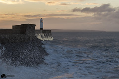 Porthcawl (Thomas Winstone) Tags: morning winter sea sun lighthouse storm beach water weather wales dawn coast seaside sand whitewater lighthouses waves wind air wave pebbles spray resort bbc welsh porthcawl gust
