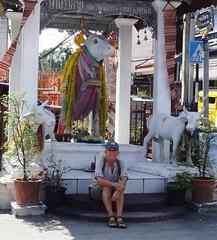 Me at Chiang Mai street shrine - Thailand (ashabot) Tags: people streetart animals thailand seasia statues chiangmai shrines streetshrines worldcities