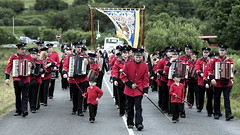 An accordion band - much loved by Orangemen.  Yes: that's King Billy fluttering in the background! (Frank Fullard) Tags: street orange march band accordion parade marchingband loyalist 12th parading redcoats donegal rossnowlagh 12thjuly orangeorder orangeparade fullard thesash accordionband frankfullard