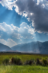 Moments Like These (www.karltonhuberphotography.com) Tags: 2016 aweinspiring bishop california clouds easternsierra fenceline freshair godrays grass invigorating karltonhuber landscape landscapephotography light mountainpeaks mountainrange nature outdoors pastureland ranchland roundvalley sky spiritual sunbeams vanadiumranch verticalimage weather wideopenspaces