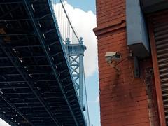 Big Brother is watching You (Hugo Malki) Tags: big brother camera america money dollar manhattan bridge blue brick red eye tsw sky street architecture old mystery olypus em5 mk2 mkii moder urban nyc sunny newyork new york city cities other face side