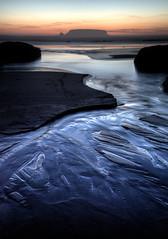 Swept Away - Otter Rock, Oregon (www.rootsstudiophoto.com) Tags: otterrock gullrock beach tide oregon coast pacificocean ottercrest westcoast pacificnorthwest sunset twilight rock formation sand reflection movement